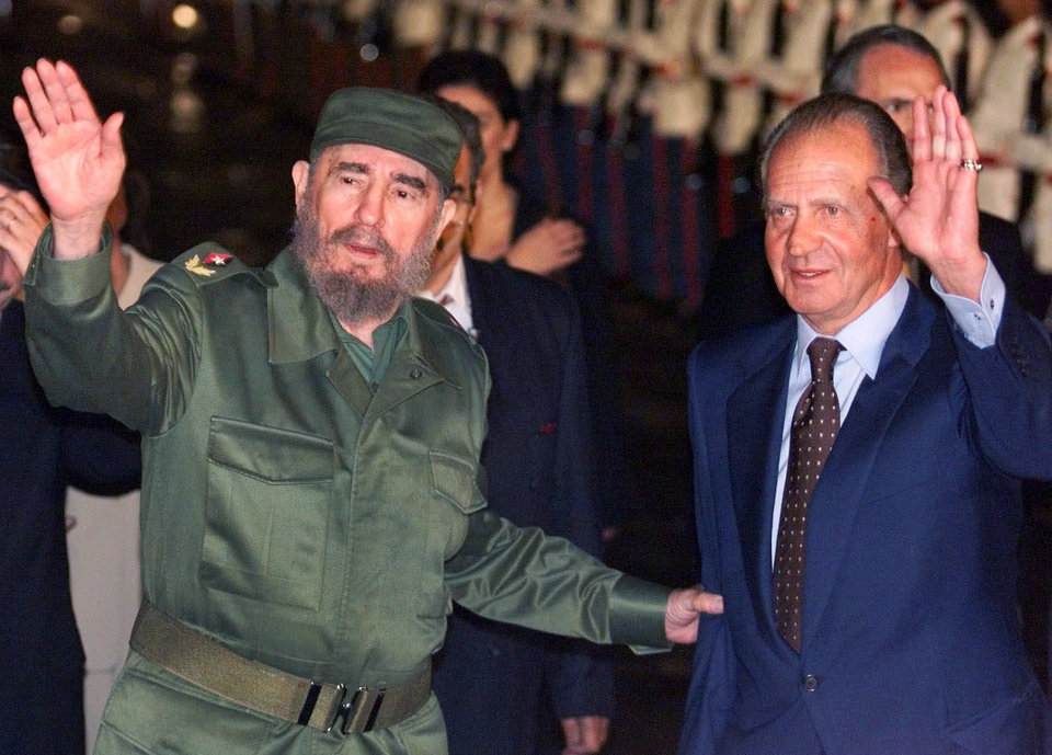 Photo - FILE - This is a  Sunday, Nov. 14, 1999 file photo of Cuba's President Fidel Castro, left, and King of Spain Juan Carlos as they wave upon the King's arrival to the Havana's airport . Spain's King Juan Carlos it was announced Monday June 2 2014 will abdicate and pave the way for his son, Crown Prince Felipe, to take over, Spanish Prime Minister Mariano Rajoy told the country Monday in an announcement broadcast nationwide.  He did not say when Juan Carlos would abdicate because the government must now craft a law creating a legal mechanism for the abdication and for 46-year-old Felipe's assumption of power.  The 76-year-old Juan Carlos oversaw his country's transition from dictatorship to democracy but has had repeated health problems in recent years. (AP Photo/Ricardo Mazalan, File)