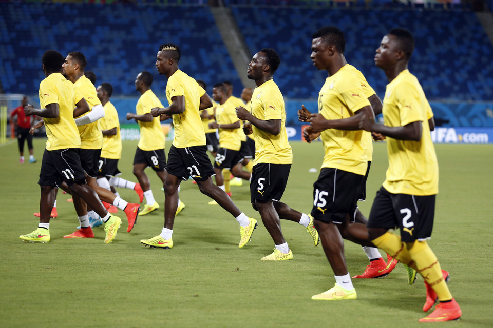 Photo - Ghana players warm up during an official training session the day before the group G World Cup soccer match between Ghana and the United States at the Arena das Dunas in Natal, Brazil, Sunday, June 15, 2014. (AP Photo/Dolores Ochoa)