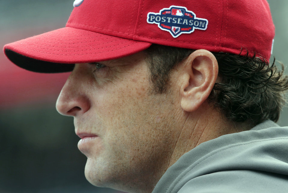 Photo -   St. Louis Cardinals manager Mike Matheny looks on as his players take batting practice before Game 3 of the National League division baseball series against the Washington Nationals on Wednesday, Oct. 10, 2012, in Washington. (AP Photo/Pablo Martinez Monsivais)