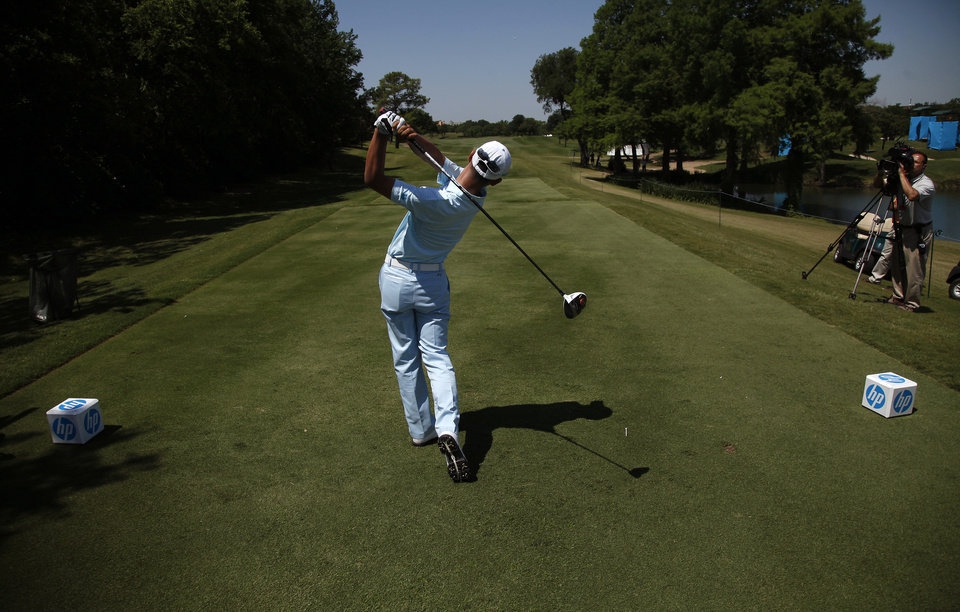 Photo - In this photo taken Tuesday, May 14, 2013, Guan Tianlang, 14, from China, tees off on the 15th hole during a practice round at Byron Nelson Championship golf tournament in Irving, Texas. (AP Photo/The Dallas Morning News, Brad Loper)  MANDATORY CREDIT; MAGS OUT; TV OUT; INTERNET USE AP MEMBERS ONLY; NO SALES.
