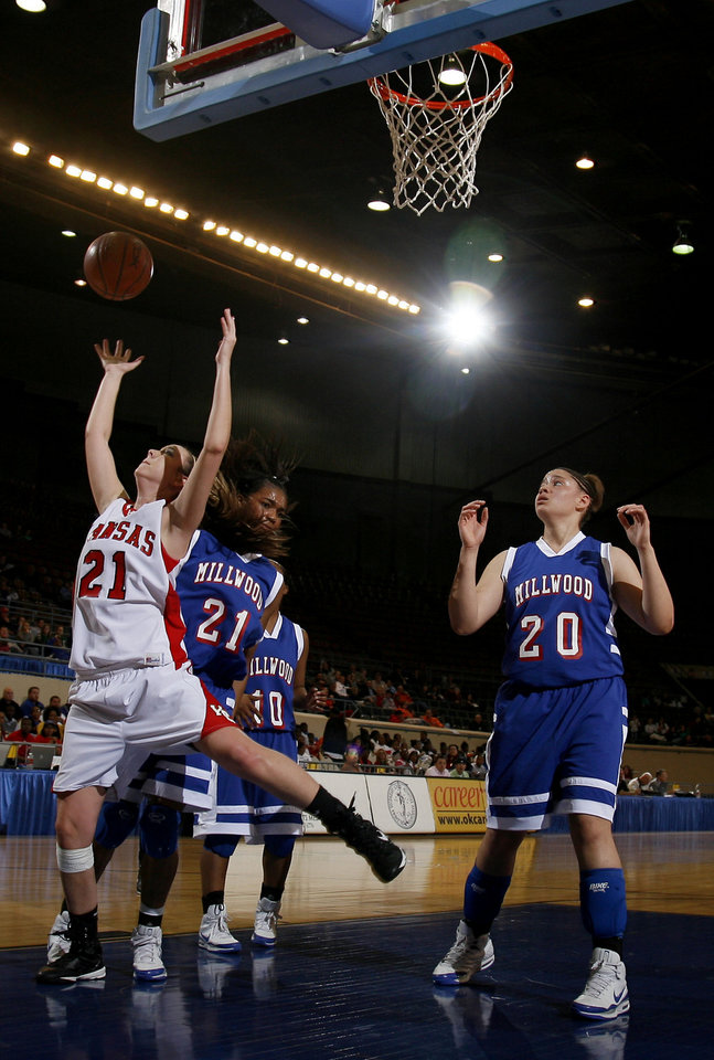 Photo - Kansas' Kortni Kendrick (21) shoots a layup in front of Millwood's JohVonna Mitchell (21), Shea Bowden (10) and Marisha Wallace (20) during the girls 3A semifinal between MIillwood and Kansas at the State Fair Arena, Friday, March 13, 2009, in Oklahoma City. PHOTO BY SARAH PHIPPS, THE OKLAHOMAN