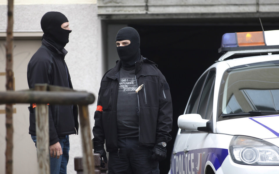 Photo -   Hooded elite police officers guard a parking lot in Torcy, east of Paris, Wednesday, Oct.10, 2012 where police found bomb-making material after police broke up a suspected terrorist cell last week. Prosecutor Francois Molins said Wednesday police investigators recovered items including potassium, sulfur, saltpeter and a pressure cooker as well as two weapons in the lot in the town of Torcy. (AP Photo/Thibault Camus)
