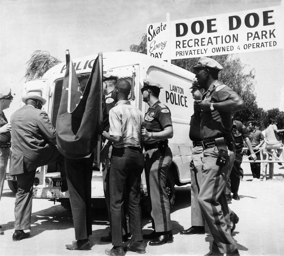 Photo - Lawton police arrest twenty-two demonstrators outside Doe Doe Amusement Park after the demonstrators blocked the entrance to the privately-owned park.  Led by Mrs. Clara Luper of Oklahoma City (one of those arrested), the demonstrators were protesting the park's segregation policy barring Negroes from the swimming pool. Staff photo taken 6/11/1966.