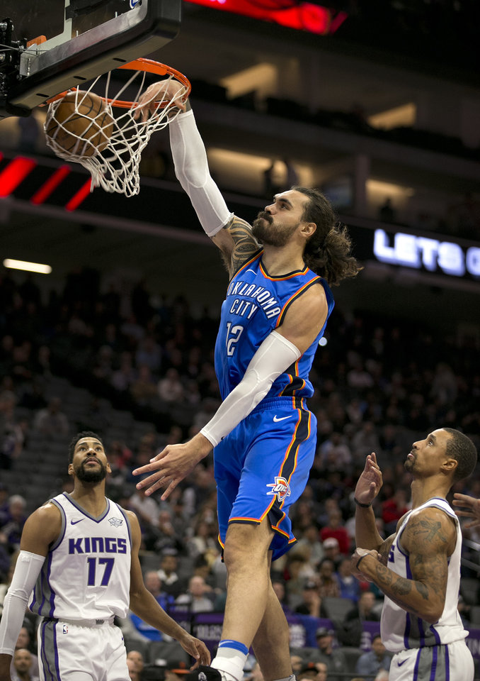 Photo - Steven Adams dunks on Sacramento in the Thunder's loss Tuesday night. (AP Photo)