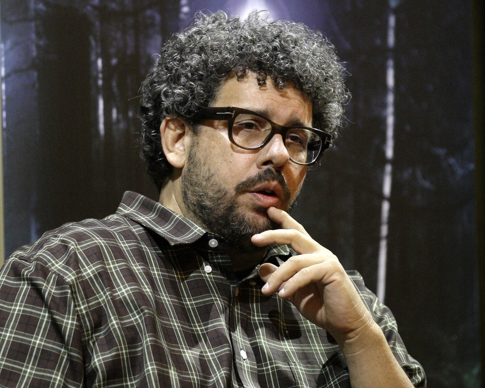 "FILE - This Nov. 22, 2010 file photo shows U.S. director, screenwriter and playwright, Neil LaBute  speaking at the Vaudeville theatre in London. LaBute's 10-minute, two person play ""In the Beginning,""  that was among the highlights of the Edinburgh Fringe Festival last summer, will make it's American debut without having ever seen it.   (AP Photo/Sang Tan, file)"