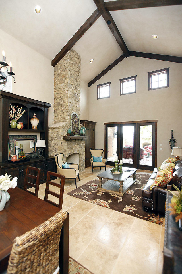 Photo - Lofty ceilings add volume to this living area in the home at 15820 Chapel Ridge Road.  PAUL HELLSTERN - The Oklahoman