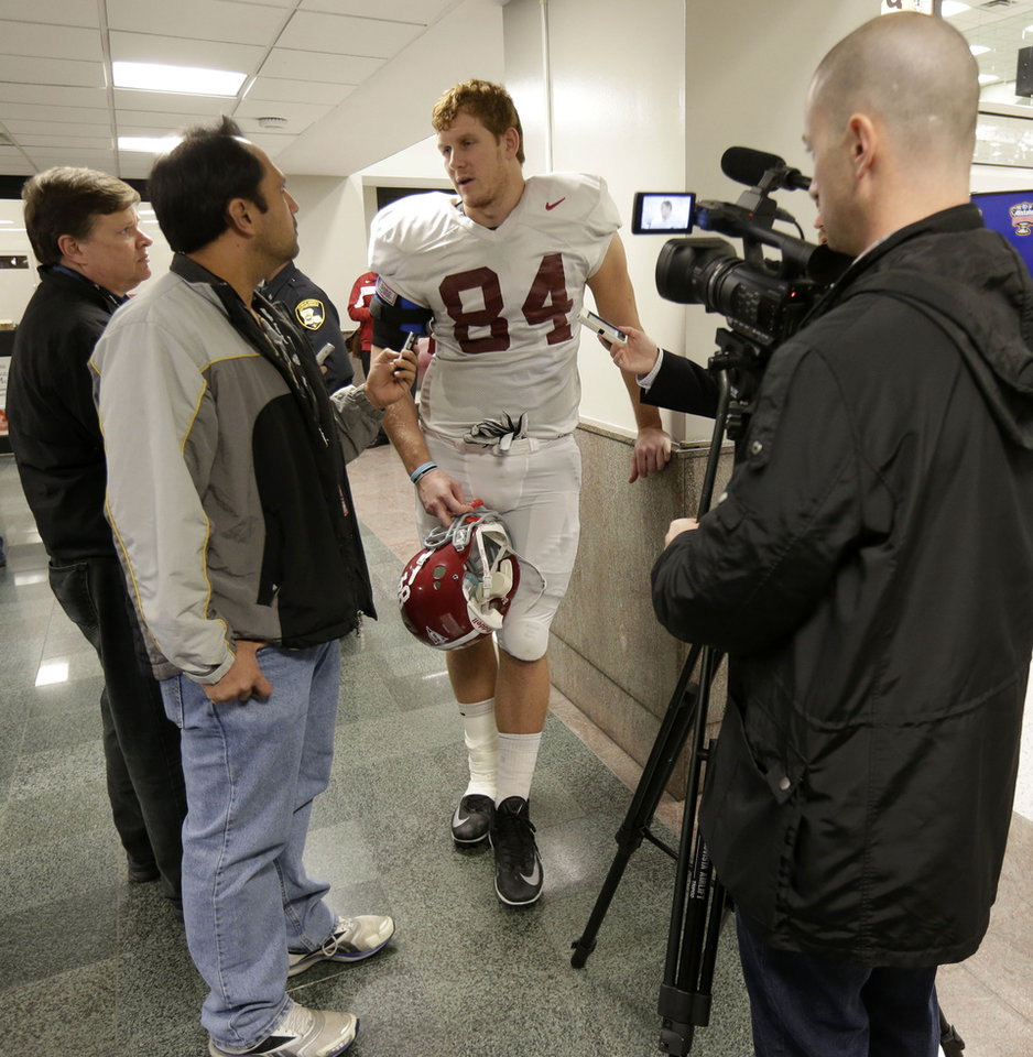 Photo - Alabama tight end Brian Vogler (84) speaks to reporters after practice for the Jan. 2 Sugar Bowl NCAA college football game against Oklahoma, in New Orleans on Saturday, Dec. 28, 2013. (AP Photo/Gerald Herbert)