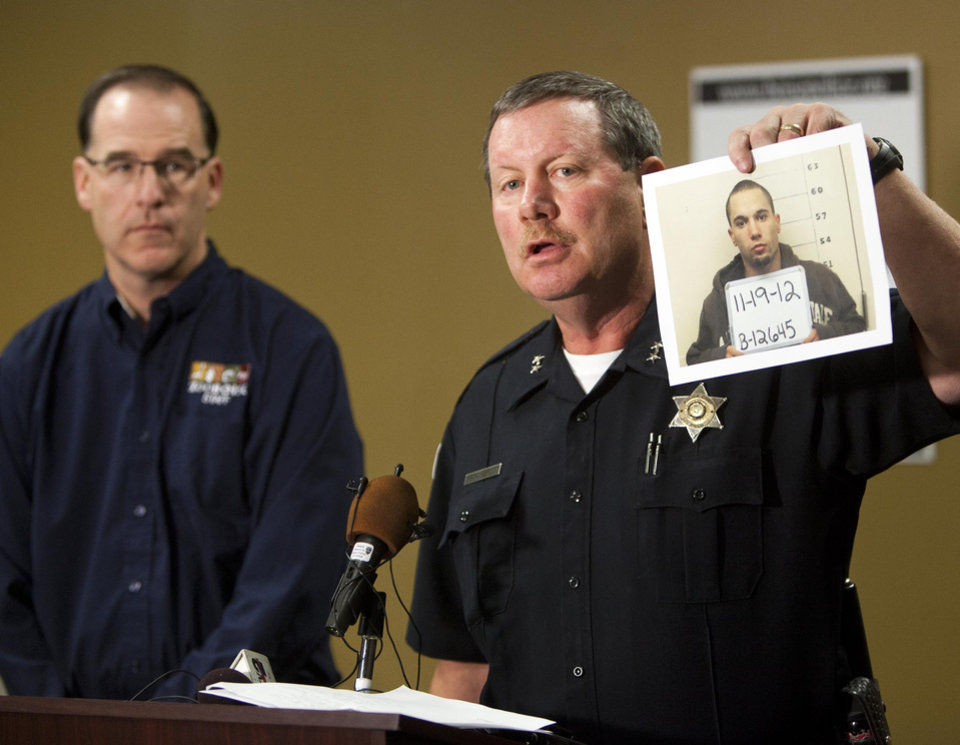 Boise Police Chief Michael Masterson, with Zoo Boise Director Steve Burns, announces the arrest of Michael J. Watkins, 22, Weiser, who investigators suspect killed a Patas monkey at Zoo Boise after breaking into the zoo early Nov. 17, at a news conference Monday Nov. 19, 2012 at the police headquarters in West Boise, Idaho. Chief Masterson said a tip provided by the community lead to the arrest. (AP Photo/The Idaho Statesman, Darin Oswald)