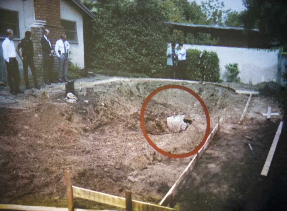 Photo - A photo of swimming pool area being unearthed 1994 and finding the remains of John Sohus in the backyard of a home on Loraine Road in San Marino is shown during final arguments by prosecutor Habib Balian in the murder trial of Christian Karl Gerhartsreiter, at Clara Shortridge Foltz Criminal Justice Center in Los Angeles Tuesday, April 9, 2013.  Gerhartsreiter  has pleaded not guilty to the killing of John Sohus, 27, who disappeared with his wife, Linda, in 1985 while Gerhartsreiter was a guest cottage tenant at the home of Sohus' mother, where the couple lived. (AP Photo/San Gabriel Valley Tribune, Pool )