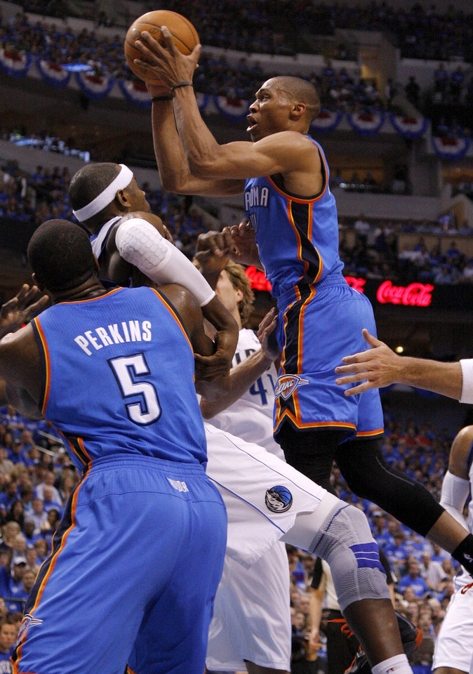 Oklahoma City's Russell Westbrook (0) goes to the basket during Game 4 of the first round in the NBA playoffs between the Oklahoma City Thunder and the Dallas Mavericks at American Airlines Center in Dallas, Saturday, May 5, 2012. Photo by Bryan Terry, The Oklahoman