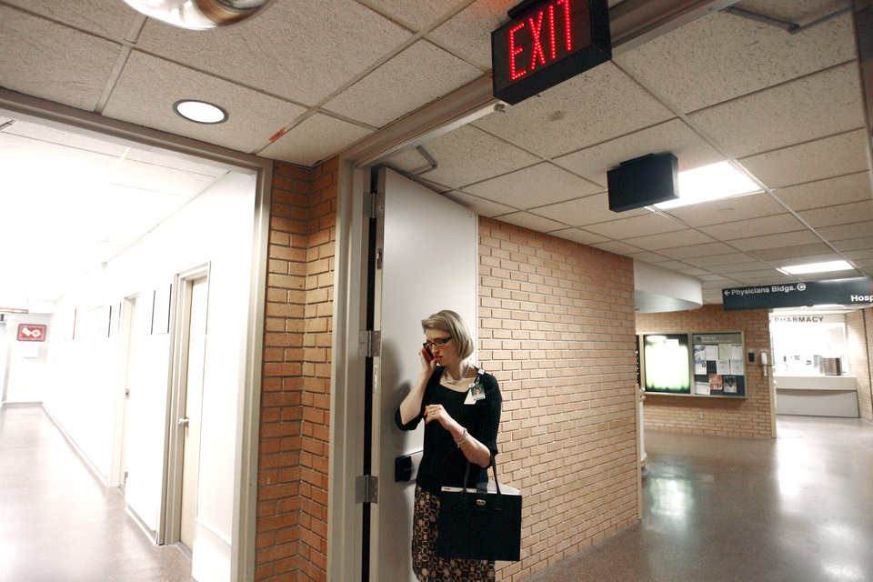 SECOND PLACE, WEB PHOTO: Tonya Ratcliff makes a phone call while leaving work at Integris Baptist Medical Center. BY SARAH PHIPPS, THE OKLAHOMAN