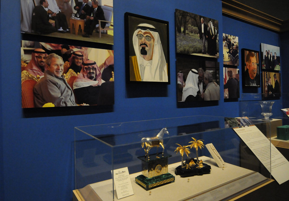 Photo - A portrait of King Abdullah of Saudi Arabia, left, which is part of the exhibit
