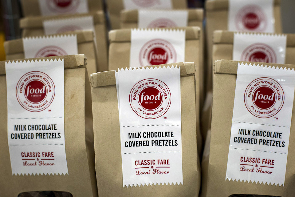 Photo -   In this Wednesday, Nov. 14, 2012 photo, bags of the Food Network Kitchen's Milk Chocolate Covered Pretzels appear on display at the Fort Lauderdale-Hollywood International Airport, in Fort Lauderdale, Fla. (AP Photo/J Pat Carter)