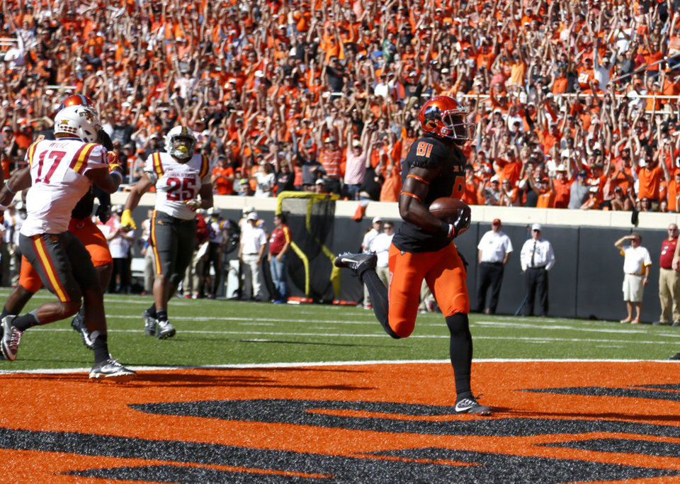 Photo - Oklahoma State's Jhajuan Seales (81) scores a touchdown in the first quarter during a college football game between the Oklahoma State University Cowboys (OSU) and the Iowa State University at Boone Pickens Stadium in Stillwater, Okla., Saturday, Oct. 8, 2016. Photo by Sarah Phipps, The Oklahoman