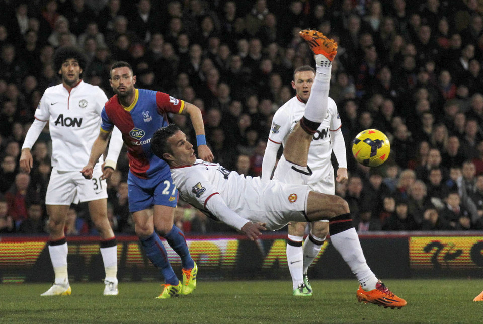 Photo - Manchester United's Robin Van Persie attempts a overhead kick at Crystal Palace's goal during their English Premier League soccer match at Selhurst Park, London, Saturday, Feb. 22, 2014. (AP Photo/Sang Tan)