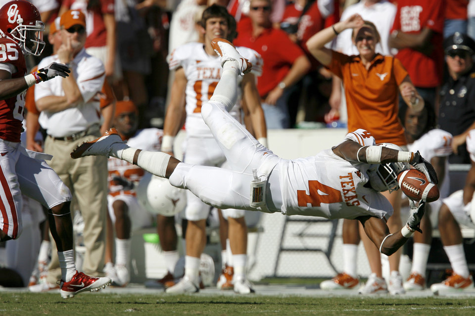 Aaron Williams of Texas misses the interception in front of OU's Ryan Broyles during the first half of the Red River Rivalry college football game between the University of Oklahoma Sooners (OU) and the University of Texas Longhorns (UT) at the Cotton Bowl on Saturday, Oct. 2, 2010, in Dallas, Texas.   Photo by Bryan Terry, The Oklahoman