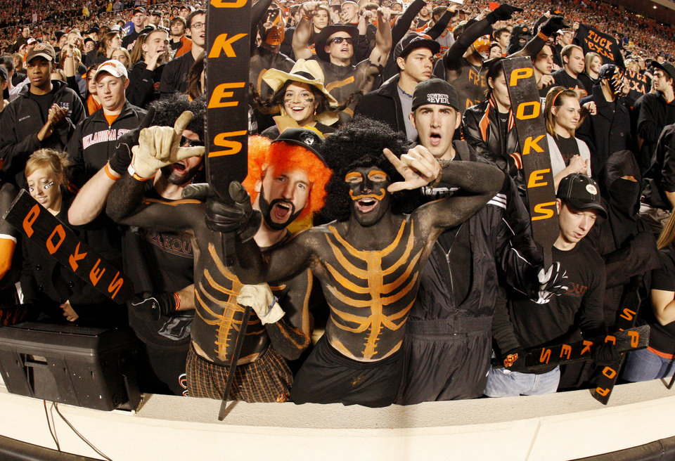 Fans get excited during the college football game between the Oklahoma State University Cowboys (OSU) and the University of Texas Longhorns (UT) at Boone Pickens Stadium in Stillwater, Okla., Saturday, Oct. 31, 2009. Photo by Doug Hoke, The Oklahoman