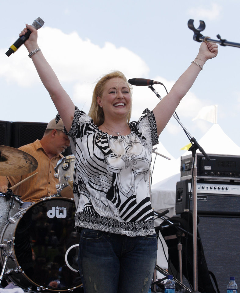 Photo - FILE - In this June 5, 2008 file photo, country music artist Mindy McCready performs at the CMA Music Festival in Nashville, Tenn. McCready, who hit the top of the country charts before personal problems sidetracked her career, died Sunday, Feb. 17, 2013. She was 37. (AP Photo/Bill Waugh, File)