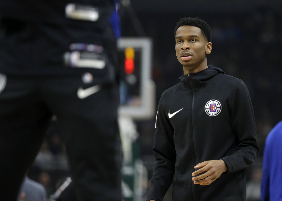 Photo - LA Clippers' Shai Gilgeous-Alexander warms up before an NBA basketball game against the Milwaukee Bucks Thursday, March 28, 2019, in Milwaukee. (AP Photo/Aaron Gash)