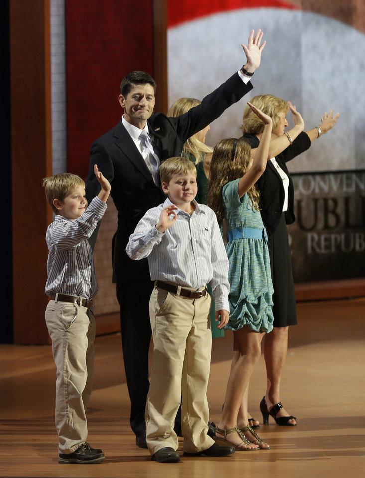 Photo -   Republican vice presidential nominee, Rep. Paul Ryan waves with his family, from left, Sam, Liza, wife Janna, Charlie and mother Betty Ryan Douglas after his acceptance speech during the Republican National Convention in Tampa, Fla., on Wednesday, Aug. 29, 2012. (AP Photo/Charlie Neibergall)