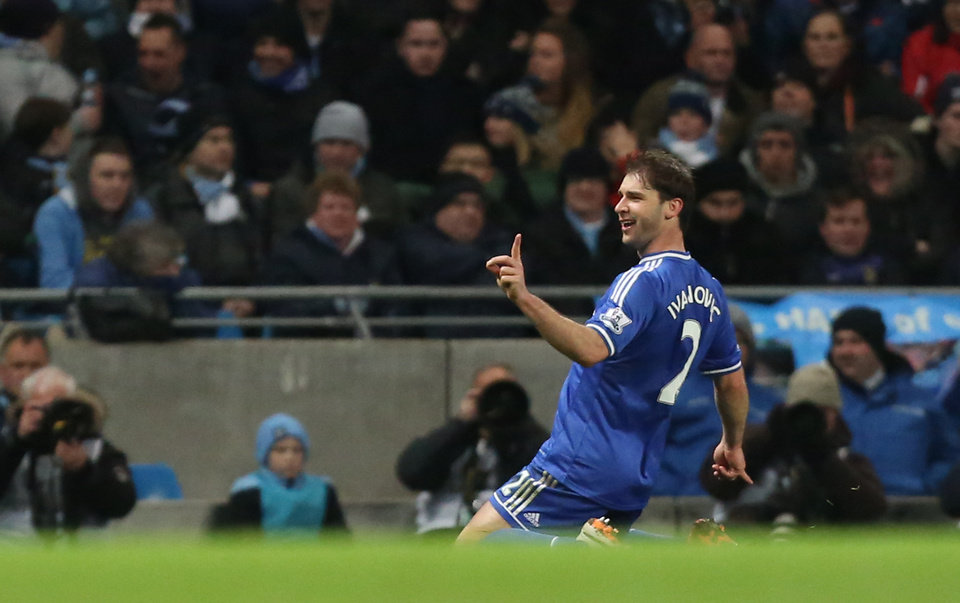 Photo - Chelsea's Branislav Ivanovic celebrates after scoring the opening during their English Premier League soccer match between Manchester City and Chelsea at the Etihad Stadium, Manchester, England, Monday, Feb. 3, 2014. (AP Photo/Jon Super)