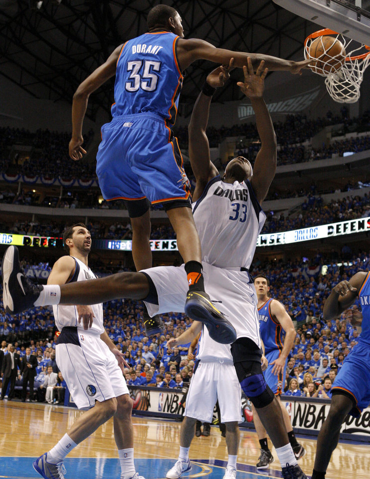 Oklahoma City's Kevin Durant (35) dunks over Brendan Haywood (33) of Dallas during game 2 of the Western Conference Finals in the NBA basketball playoffs between the Dallas Mavericks and the Oklahoma City Thunder at American Airlines Center in Dallas, Thursday, May 19, 2011. Photo by Bryan Terry, The Oklahoman