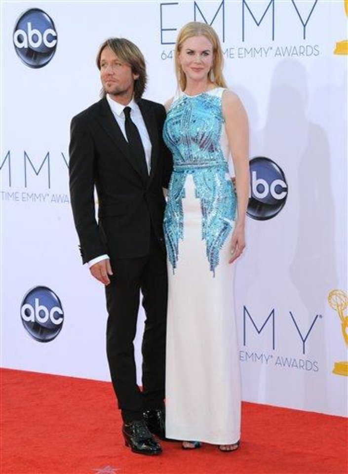 Musician Keith Urban, left and actress Nicole Kidman arrive at the 64th Primetime Emmy Awards at the Nokia Theatre on Sunday, Sept. 23, 2012, in Los Angeles.  (Photo by Jordan Strauss/Invision/AP)
