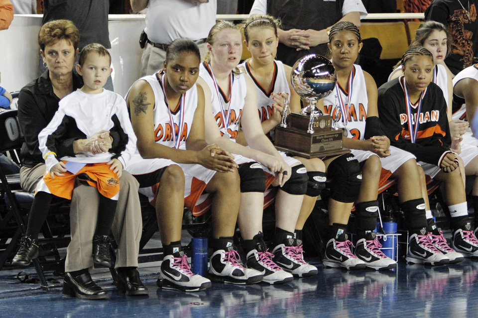 Photo - The Norman Lady Tigers sit on the bench with the runner-up trophy after the Class 6A girls high school basketball state tournament final between Midwest City and Norman at the ORU Mabee Center in Tulsa, Okla., Saturday, March 13, 2010. Midwest City won, 46-32. Photo by Nate Billings, The Oklahoman