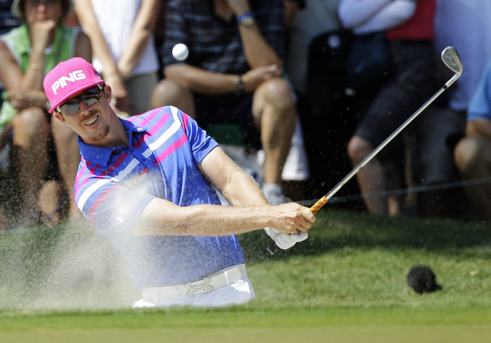 Photo -   Hunter Mahan hits from the sand on the eighth hole during the second round of the Players Championship golf tournament at TPC Sawgrass, Friday, May 11, 2012, in Ponte Vedra Beach, Fla. (AP Photo/John Raoux)