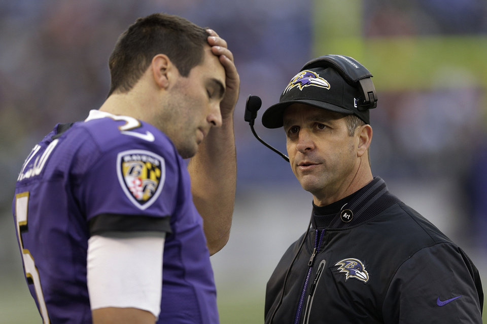Photo - Baltimore Ravens head coach John Harbaugh looks at quarterback Joe Flacco as he walks off the field during the second half of an NFL football game against the Denver Broncos in Baltimore, Sunday, Dec. 16, 2012. (AP Photo/Patrick Semansky)