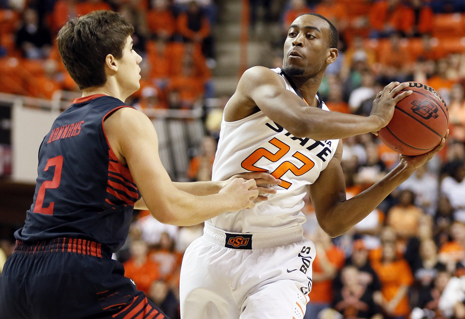 Oklahoma State's Markel Brown (22) looks to pass around Texas Tech's Dusty Hannahs (2) during a men's college basketball game between Oklahoma State University (OSU) and Texas Tech at Gallagher-Iba Arena in Stillwater, Okla., Saturday, Jan. 19, 2013.  Photo by Nate Billings, The Oklahoman