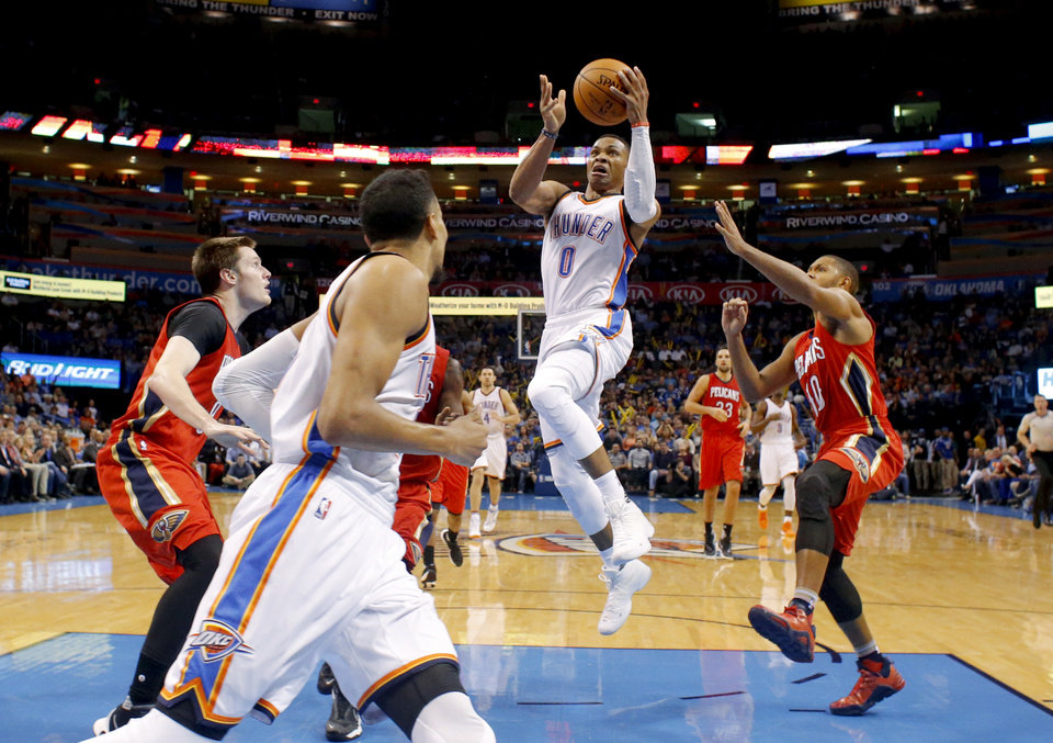 Photo - Oklahoma City's Russell Westbrook (0) goes tot the basket during an NBA game between the Oklahoma City Thunder and the New Orleans Pelicans at Chesapeake Energy Arena in Oklahoma City, Wednesday, Nov. 18, 2015. Oklahoma City won 110-103. Photo by Bryan Terry, The Oklahoman