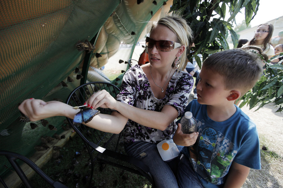 Monica Edson and her son Hayden, 5, interact with butterflies at the Oklahoma State Fair in Oklahoma City, Friday, Sept. 21, 2012.  Photo by Garett Fisbeck, The Oklahoman