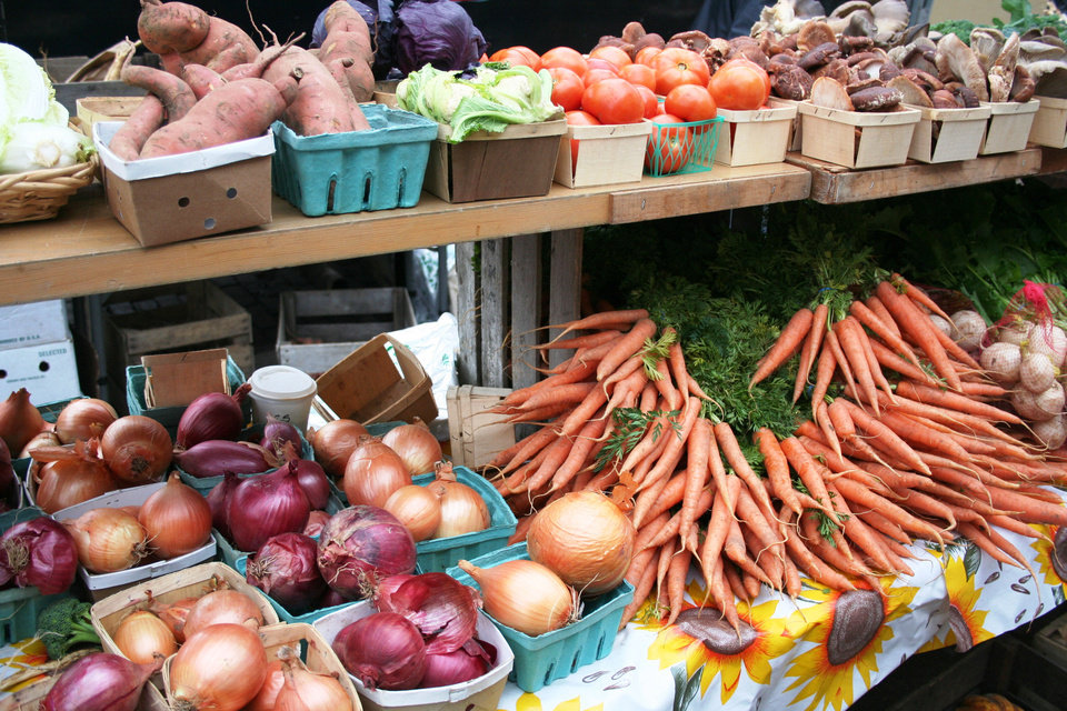 The bountiful farmers market in Ann Abor, Mich., include carrots, hot house tomatoes, onions, root vegetables and radishes. <strong>DAVE CATHEY - THE OKLAHOMAN</strong>