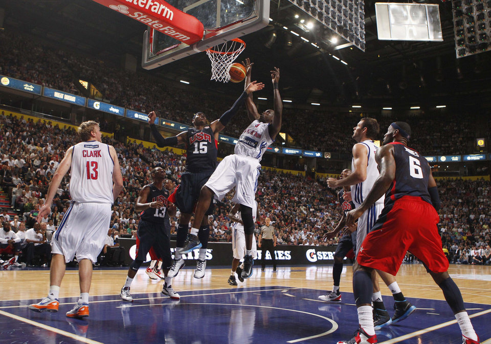 Photo -   Great Britain's Luol Deng and Carmelo Anthony during an Olympic Warm Up match against the USA at the Manchester Arena, Manchester Thursday July 19, 2012. (AP Photo/ Dave Thompson/PA Wire) UNITED KINGDOM OUT