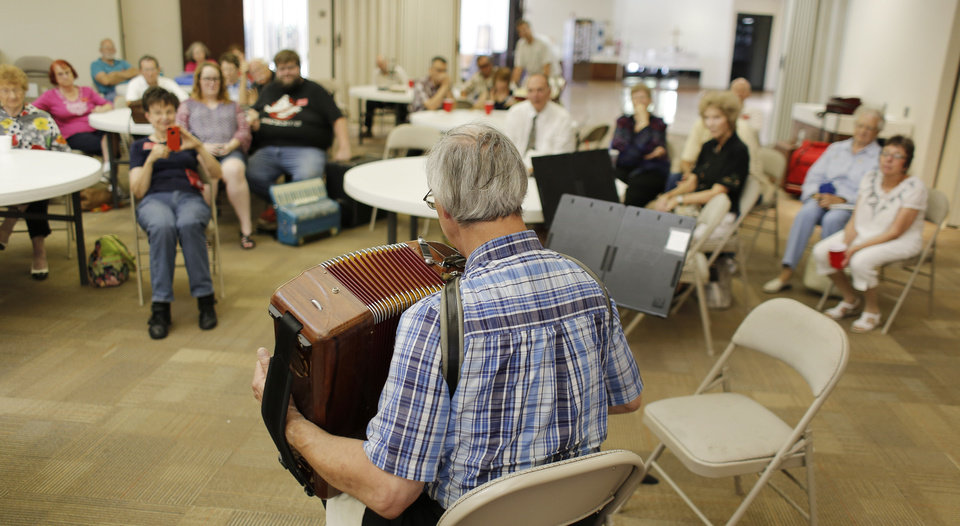 Photo -  Club members listen as George Secor plays at the monthly meeting of the Oklahoma City Accordion Club. Photo by Doug Hoke, The Oklahoman   DOUG HOKE