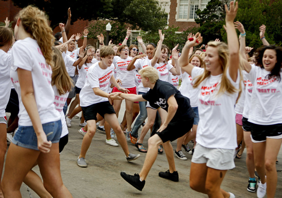 Photo - A flash mob of Norman High School students dance to the Michael Jackson song