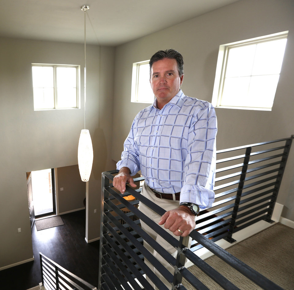 Photo - Builder Jay Johnston shows one of Johnston Builders' townhomes in The Village.  Steve Gooch - The Oklahoman
