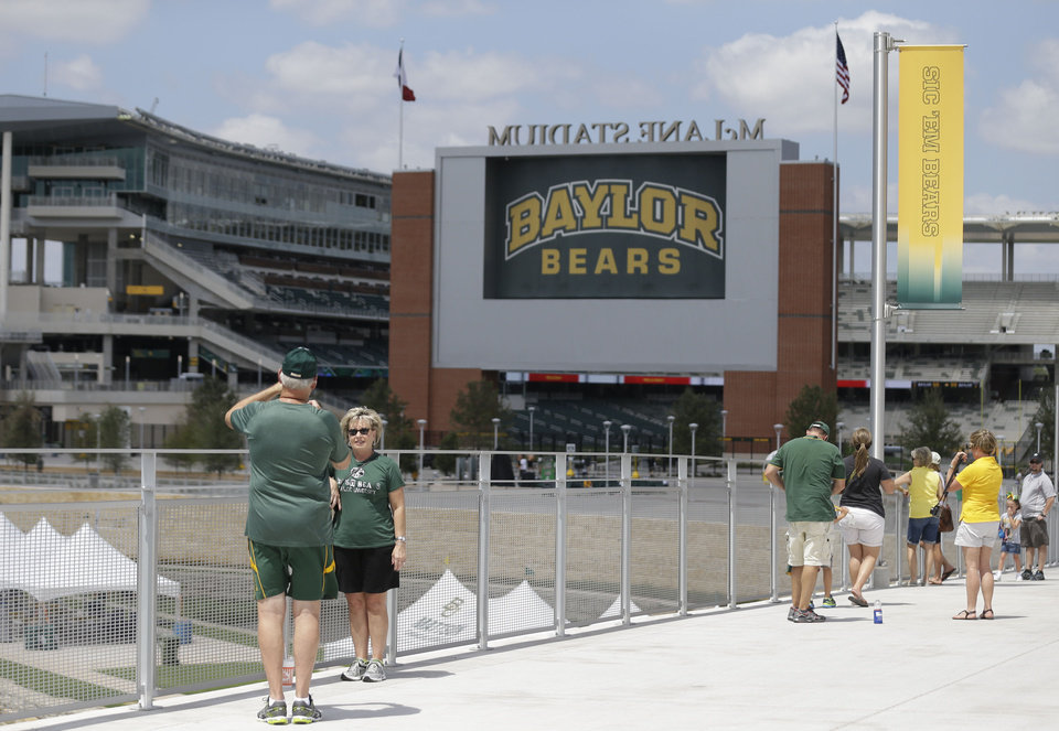 Photo - Fans head to the new McLane Stadium before the NCAA college football game between SMU and Baylor, Sunday, Aug. 31, 2014, in Waco, Texas. (AP Photo/LM Otero)