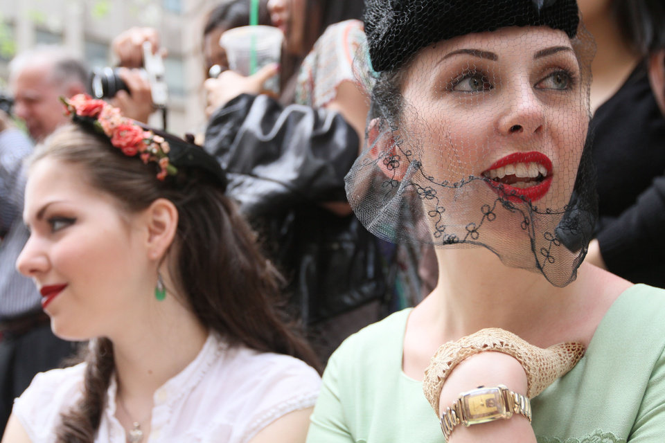 Photo -   Daphne Malfitano, of the Brooklyn borough of New York, right, smiles as she and others take part in the Easter Parade along New York's Fifth Avenue Sunday April 24, 2011. (AP Photo/Tina Fineberg)