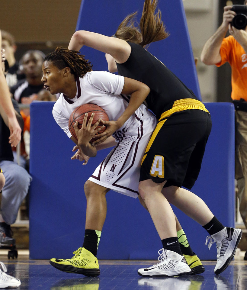 Danielle Gaddis gets a rebound in front of Morgan Shiever during the 2A girls championship game between the Northeast Academy Lady Vikings and the Alva high school Lady Bugs at the State Fair Arena on Saturday, March 9, 2013 in Oklahoma City, Okla.  Photo by Steve Sisney, The Oklahoman