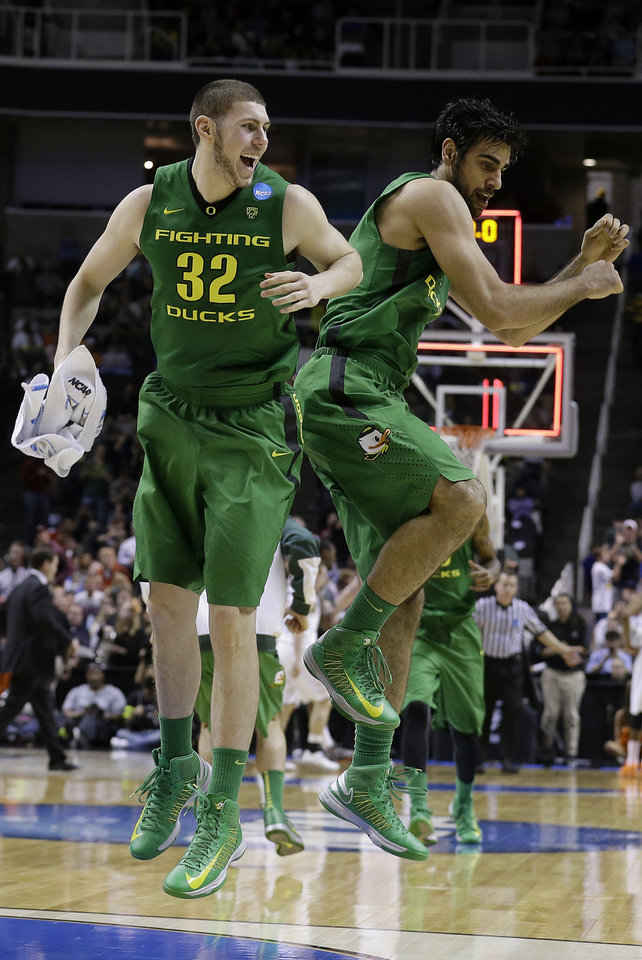 Oregon forward Ben Carter (32) and forward Arsalan Kazemi celebrate at the end of the first half of a second-round game in the NCAA college basketball tournament against Oklahoma State in San Jose, Calif., Thursday, March 21, 2013. (AP Photo/Jeff Chiu) ORG XMIT: SJA122