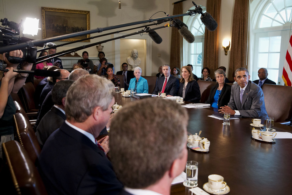 Photo - President Barack Obama meets with his cabinet members in the Cabinet Room of the White House in Washington, Tuesday, July 1, 2014. From left are National Security Adviser Susan Rice, Environmental Protection Agency Administrator Gina McCarthy, Education Secretary Arne Duncan, Health and Human Services Secretary Sylvia Burwell, and Interior Secretary Sally Jewell. (AP Photo/Jacquelyn Martin)
