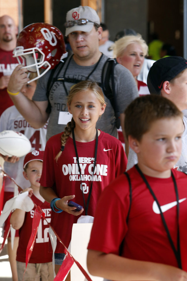 Photo - Shelby Schumacher, 13, from Grapevine, Texas, waits in line during the Meet the Sooners event inside Gaylord Family/Oklahoma Memorial Stadium at the University of Oklahoma on Saturday, Aug. 4, 2012, in Norman, Okla.  Photo by Steve Sisney, The Oklahoman