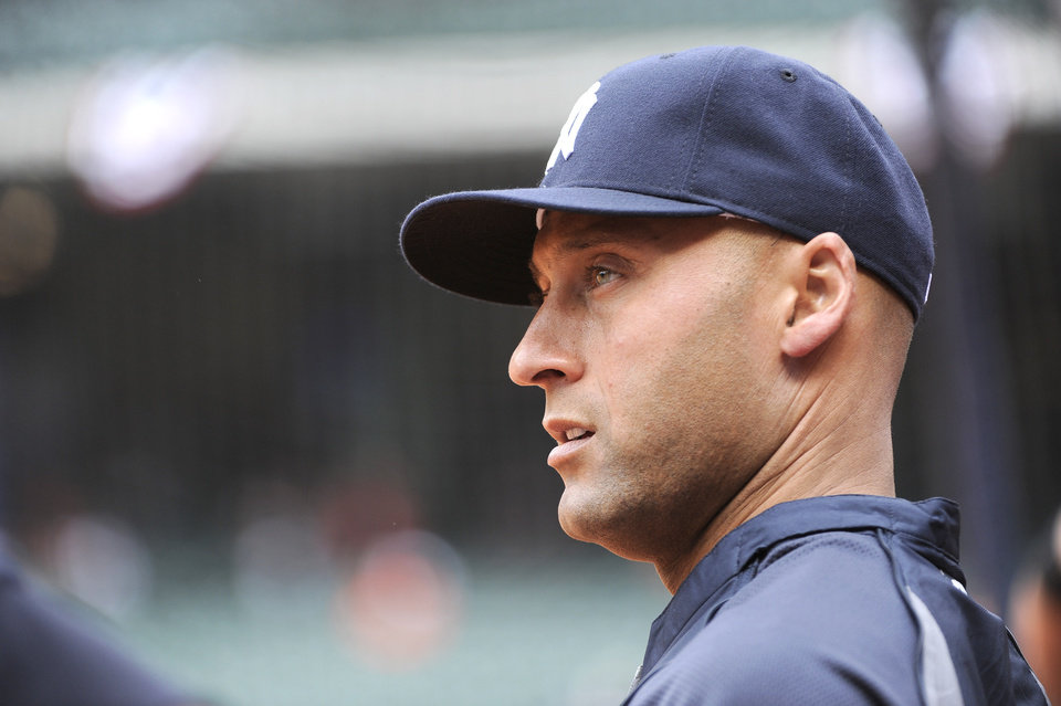 Photo - New York Yankees' Derek Jeter looks out to the field before a baseball game against the Houston Astros on opening day Tuesday, April 1, 2014, in Houston. (AP Photo/Pat Sullivan)