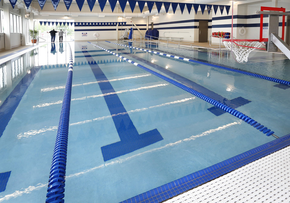 Photo -  A saltwater swimming pool is available to members of the wellness center. [PHOTO BY JIM BECKEL, THE OKLAHOMAN]