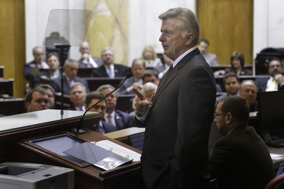 Arkansas Gov. Mike Beebe gestures as he delivers his State of the State address to legislators in the House chamber at the Arkansas state Capitol in Little Rock, Ark., Tuesday, Jan. 15, 2013.   (AP Photo/Danny Johnston)