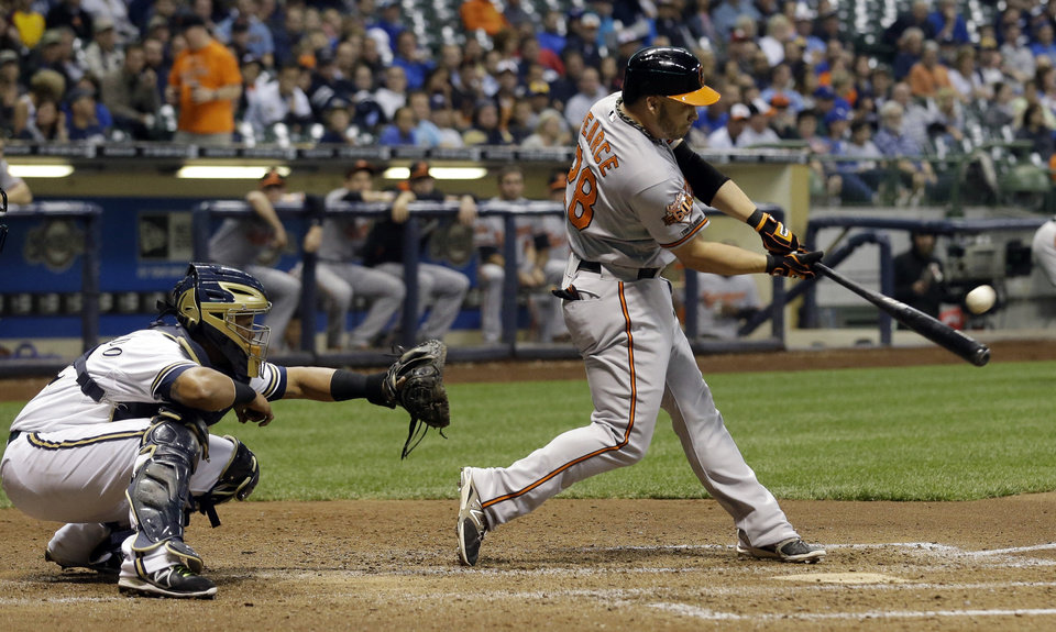 Photo - Baltimore Orioles' Steve Pearce hits a three-run home run during the seventh inning of a baseball game against the Milwaukee Brewers Tuesday, May 27, 2014, in Milwaukee. (AP Photo/Morry Gash)