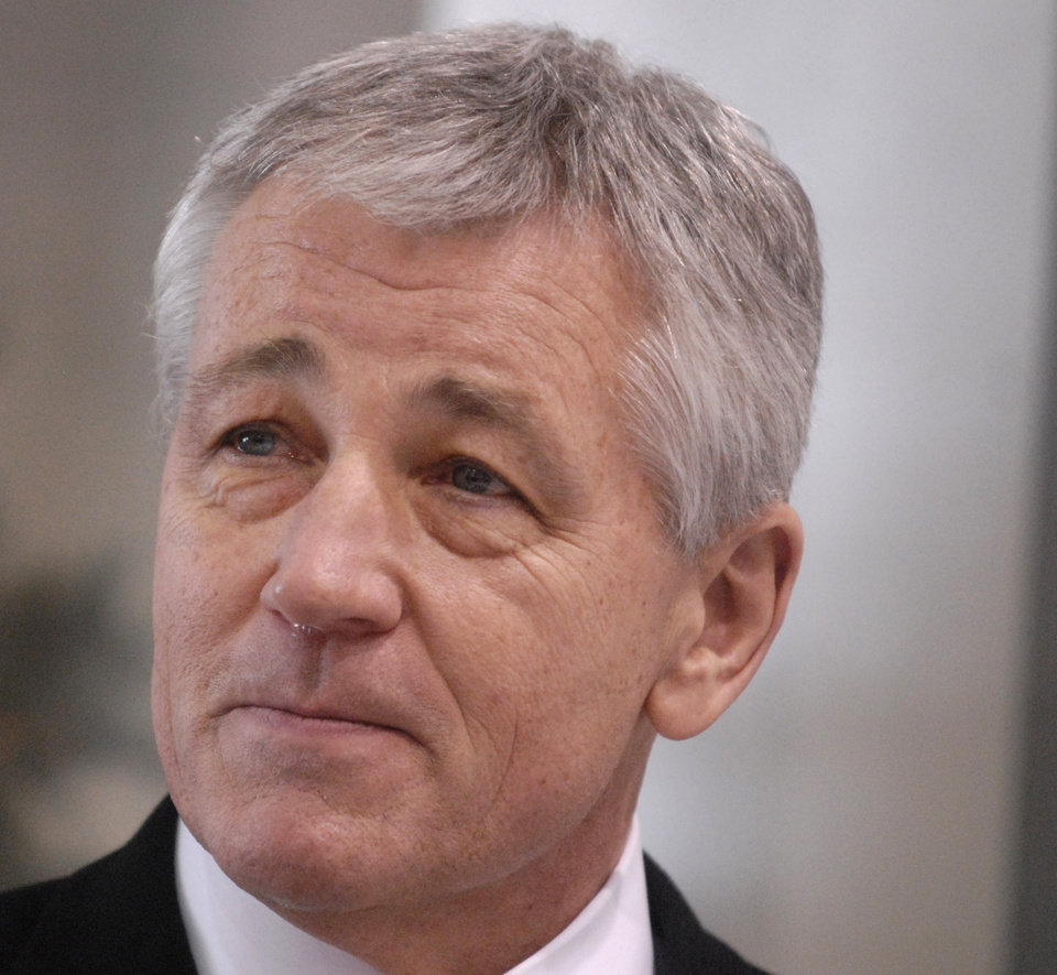 Photo - FILE - This Dec, 18, 2008 file photo shows then-Nebraska Sen. Chuck Hagel in Omaha, Neb. Senior administration officials tell The Associated Press that President Barack Obama could name his next defense secretary in December, far sooner than expected and perhaps in a high-powered package announcement along with his choice for secretary of state. The top names under consideration for defense secretary are former Republican Sen. Chuck Hagel of Nebraska, deputy defense secretary Ashton Carter, former top Pentagon official Michele Flournoy, and Sen. John Kerry, D-Mass.  (AP Photo/Dave Weaver, File)