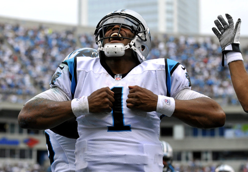 Photo -   Carolina Panthers' Cam Newton (1) reacts after running for a touchdown against the New Orleans Saints during the fourth quarter of an NFL football game in Charlotte, N.C., Sunday, Sept. 16, 2012. The Panthers won 35-27. (AP Photo/Rainier Ehrhardt)